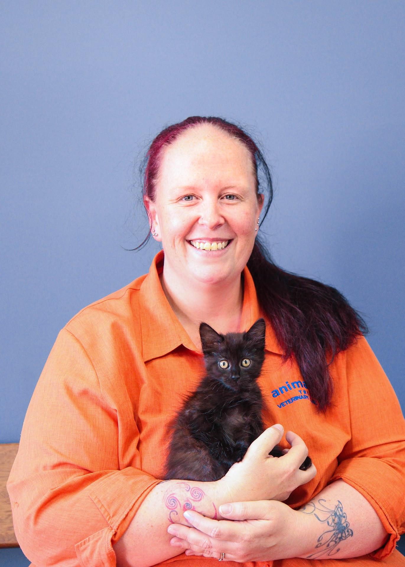 Animal Tracks Vet Nurse Nicole with a fluffy black kitten